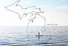 Michigan map overlayed on paddle-boarder.